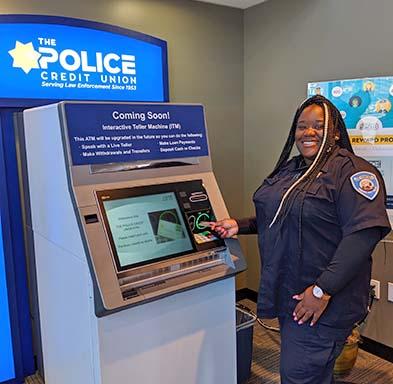 Ronnae C. using new ATM
