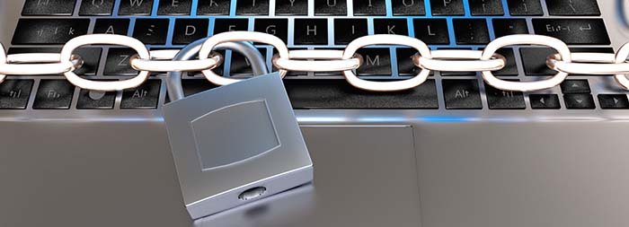 A chain and padlock on a MacBook keyboard