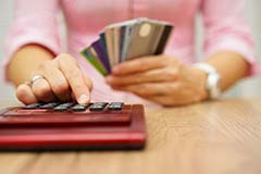 Woman with credit cards and a calculator