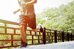 Man jogging on a bridge