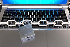 Chain and padlock across a MacBook