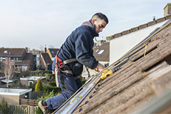 A contractor working on a roof