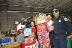 Employees surrounded by toy donations