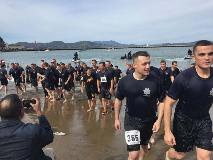 Employees walking out of the sea after a polar plunge