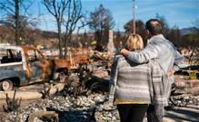Couple viewing a wreckage