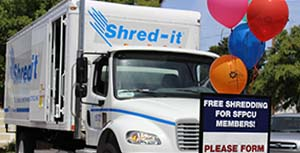 A shred truck parked at our San Mateo branch with balloons in the foreground
